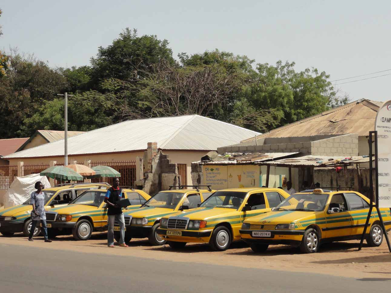 Gambian taxis with go faster stripes